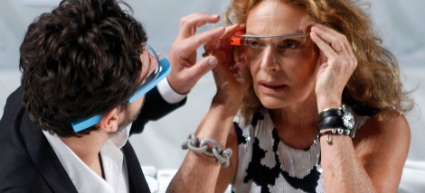 Google founder Brin adjusts a pair of Project Glass glasses on designer von Furstenberg before the rehearsal for von Furstenberg's Spring/Summer 2013 collection show during New York Fashion Week